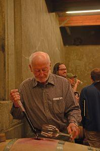 Winemaker Philip Togni pulling barrel samples for tasting